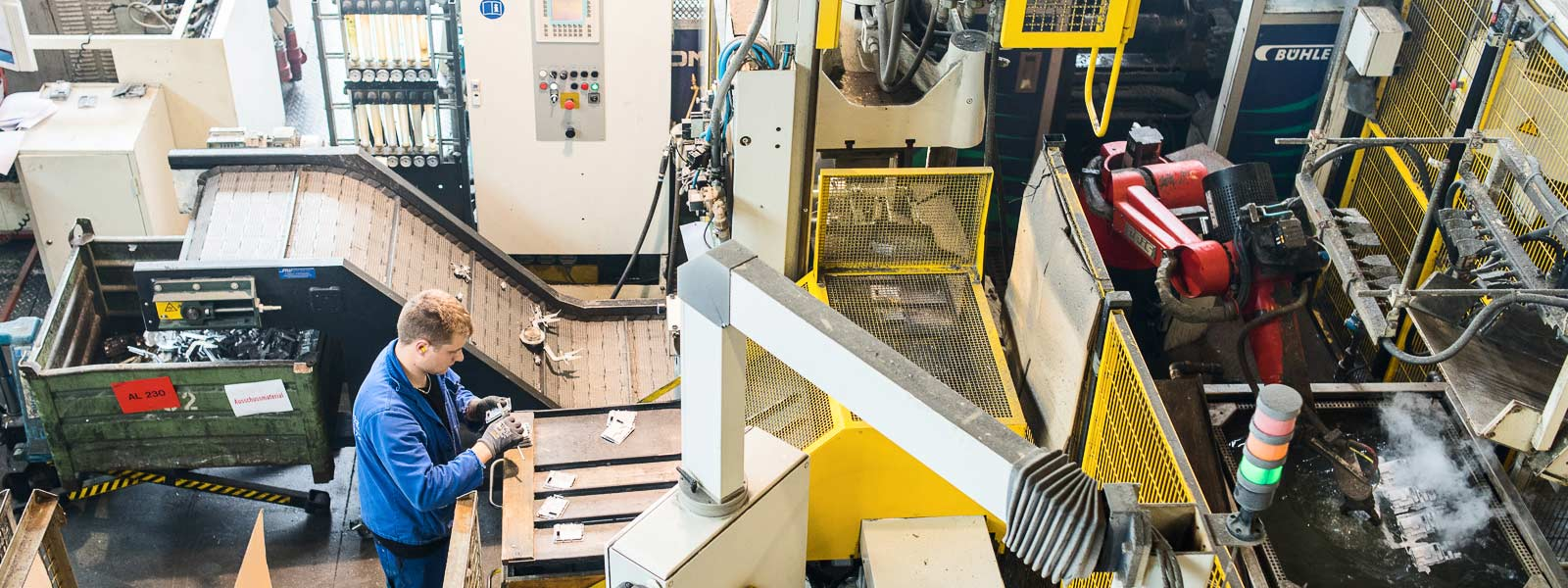 Employee working on fully automated die casting cell