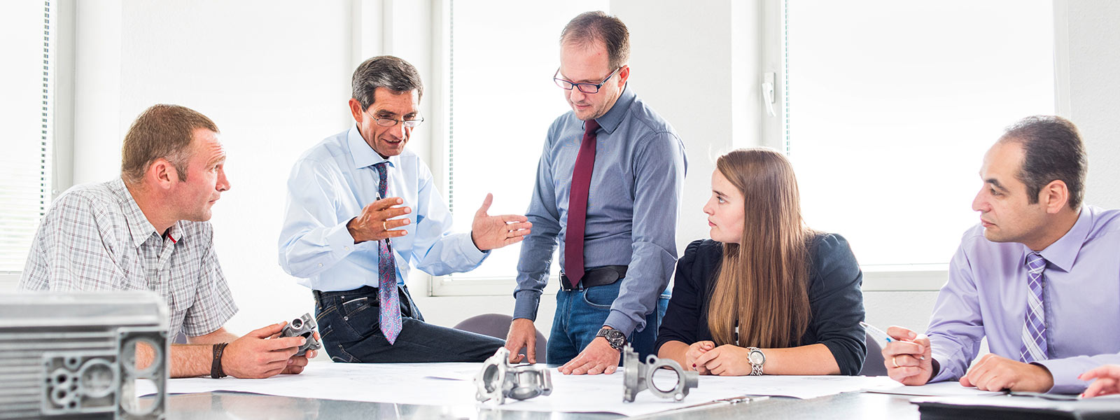 Five employees in a team meeting